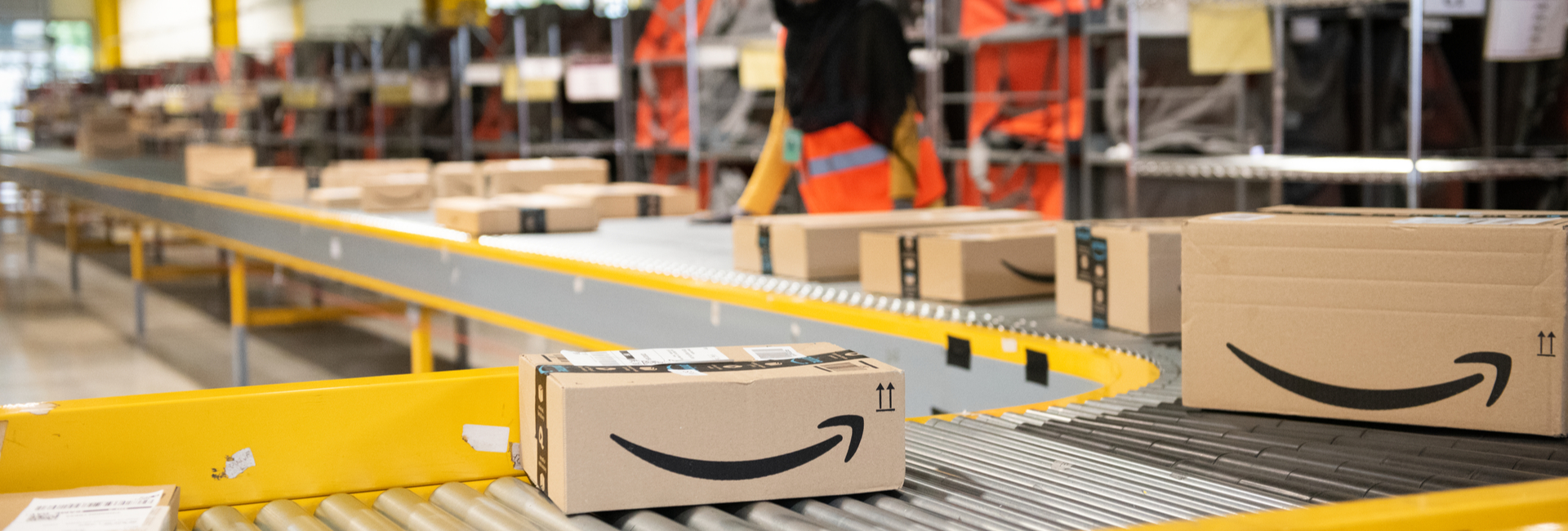 an Amazon package on a conveyor belt in an Amazon warehouse